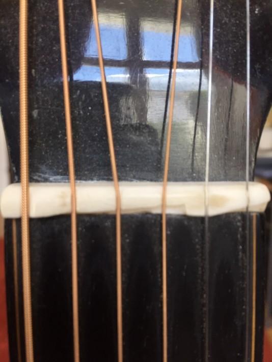Gekürztes Griffbrett mit kompensiertem Sattel